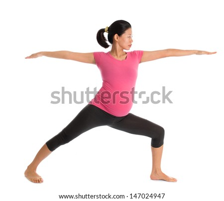 Prenatal yoga class. Full length healthy Asian pregnant woman doing yoga exercise stretching at home, full body isolated on white background. Yoga positions warrior pose 2. - stock photo