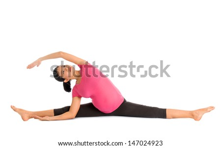 Prenatal yoga. Full length Asian pregnant woman doing gymnastic stretching, full body isolated on white background. - stock photo