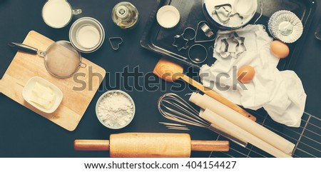 Preparation Baking Accessories Kitchen Composition Black Table Top Wooden Metal Dishes Table Ware Fresh Grocery Different Support Stuff Toned - stock photo