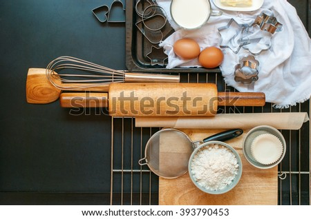 Preparation Baking Kitchen Composition Black Table Top Wooden Metal Dishes Table Ware Fresh Grocery Different Stuff - stock photo