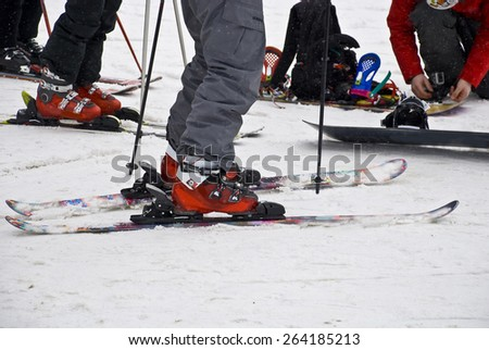 Preparation for descent from the mountain. Alpine skiing equipment. - stock photo