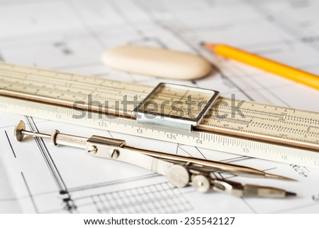 Preparation for drafting papers, the tools and schemes on the ta - stock photo