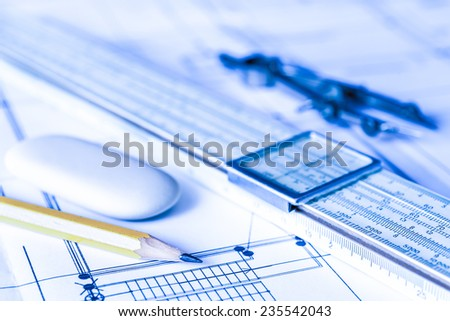 Preparation for drafting papers, the tools and schemes on the table. Angle view, focus on a pencil, in blue tone - stock photo