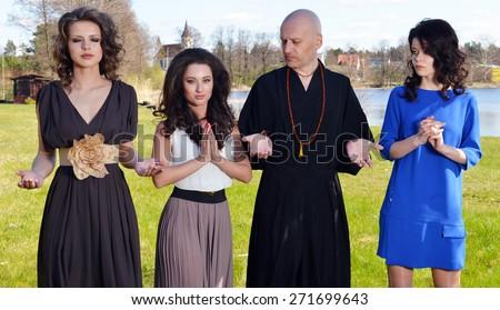 Preparation for meditation outdoors, women and guru - stock photo