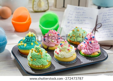Preparation for sweet cupcakes with cream and decoration - stock photo