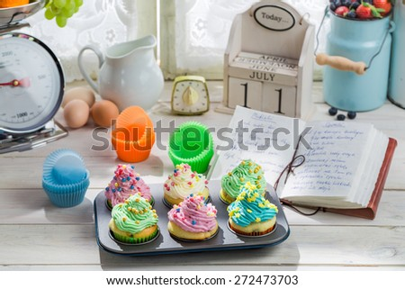 Preparation for sweet muffins with cream - stock photo