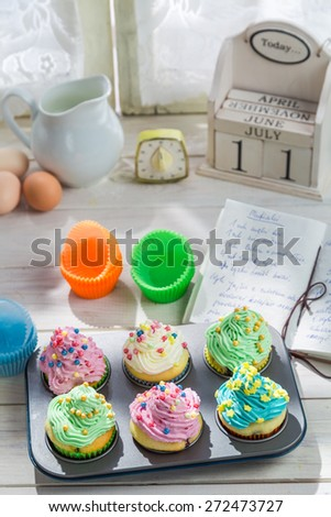 Preparation for tasty cupcakes with cream - stock photo