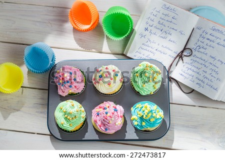 Preparation for tasty cupcakes with sweet cream - stock photo