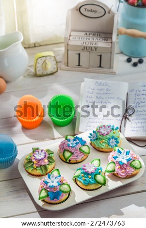 Preparation for tasty muffins with sweet cream - stock photo