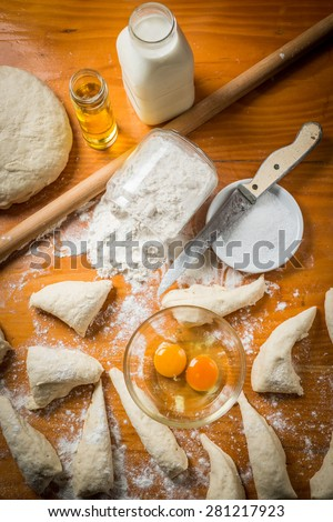 Preparation of bread and rolls in the kitchen. Kneading - stock photo