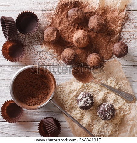 Preparation of chocolate truffles on the table close-up. view from above - stock photo