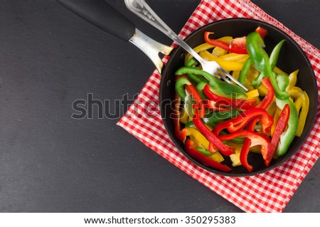 Preparation of colored paprika stew with other vegetables - stock photo
