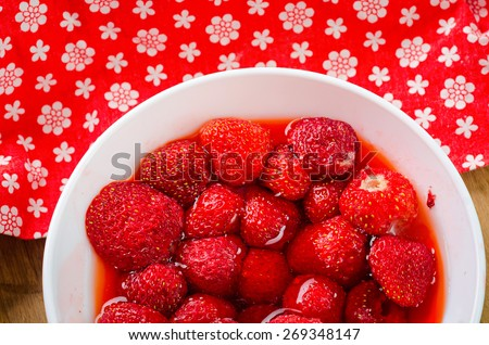 Preparation of delicious sweet cake flavored with ripe red strawberry - stock photo