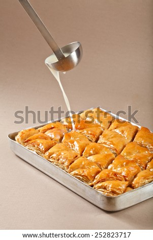 preparation of of turkish and iran baklava filling oil and scherbet - stock photo