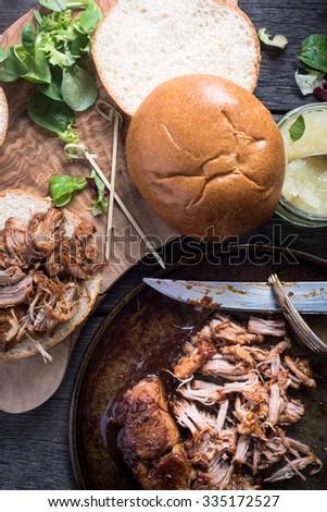 preparation of pulled pork sandwich - stock photo