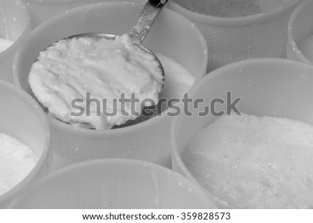 Preparation of ricotta in a dairy - stock photo