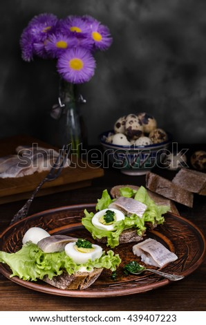 Preparation of sandwiches with herring, selective focus, still life - stock photo