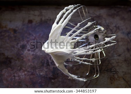 Preparation of whipped cream with a hand mixer metal,still life image dark tone. - stock photo