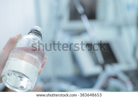 Preparations for infusion therapy in hospital ward. - stock photo