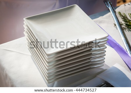 Preparations for the wedding cake cutting ceremony. - stock photo