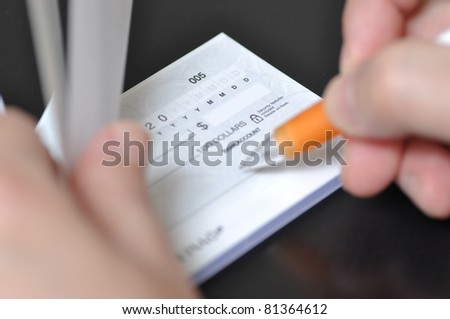 Prepare writing a check - stock photo