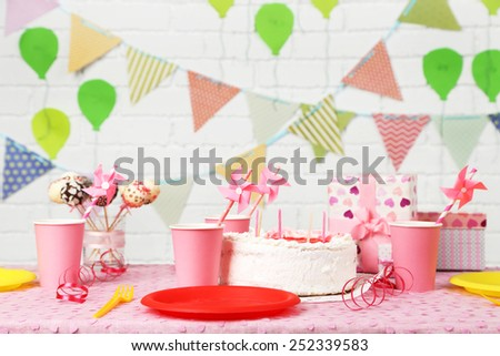 Prepared birthday table for children party - stock photo