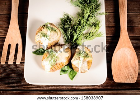 prepared chopped potatoes are served on dish with basil sauce and fennel - stock photo