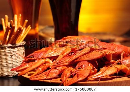 Prepared crawfish and glasses of beer, close up - stock photo