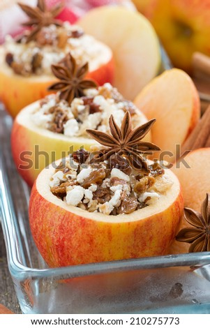 prepared for baking stuffed apples in a glass form, close-up, vertical - stock photo