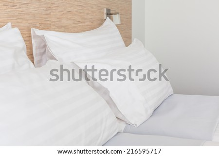 Prepared fresh bed, scene in hotel room. Horizontal shot - stock photo