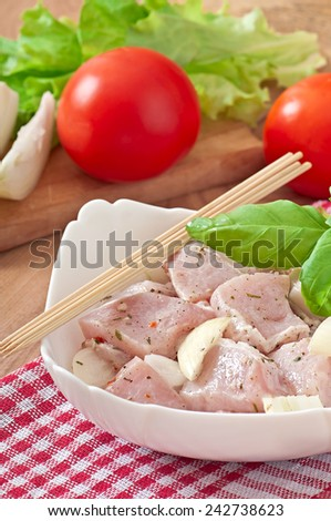 Prepared marinated with onions and herbs pieces of meat for barbecue - stock photo