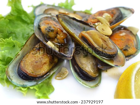Prepared oysters in vinegar with garlic chives served on lettuce leaves, close up food still life on white background, delicatessen restaurant dish - stock photo
