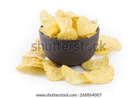 Prepared potato chips snack closeup view on white background - stock photo