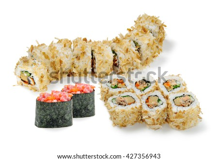 Prepared recipe of sushi in the foreground of the camera. Delicious set with eel, caviar, tuna and cucumber. International delicacy. - stock photo