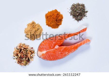 Prepared salmon steak with spices and seasonings top view - stock photo