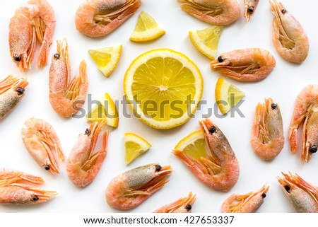 Prepared shrimps with lemon. Flat lay pattern. Nature background - stock photo