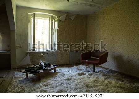 prepared weapons, abandoned house ruined, mess, interior - stock photo