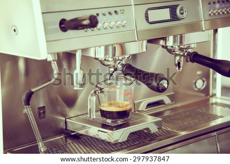 Prepares espresso in coffee shop ( Filtered image processed vintage effect. ) - stock photo