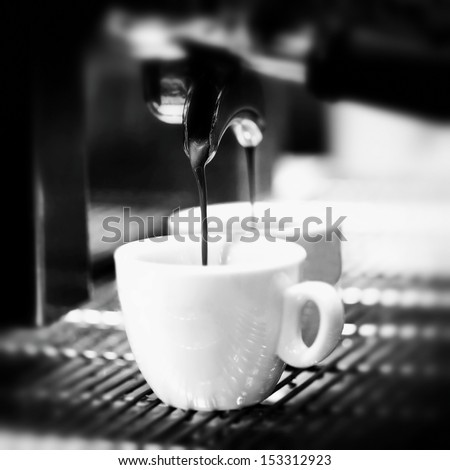 Prepares espresso in his coffee shop; close-up counter espresso automatic cappuccino bari sta portability coffee-shop coffee shop coffee mill coffee house coffee machine coffee dispenser - stock photo