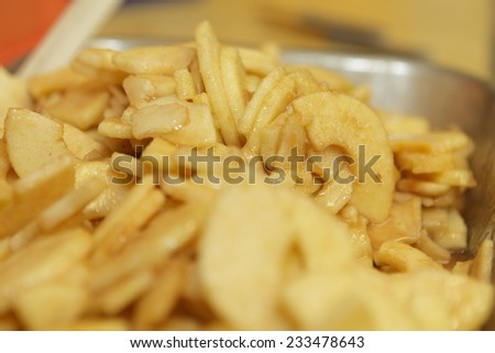 Preparing apple pies in a large commercial kitchen for the holidays with homemade pie crust â?? part of a series - stock photo