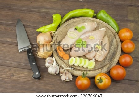 Preparing Diet food. Fresh raw chicken fillet and vegetables prepared for cooking. Fresh raw chicken breasts. Preparing chicken at a summer barbecue. Cooking with fresh dietary ingredients.  - stock photo