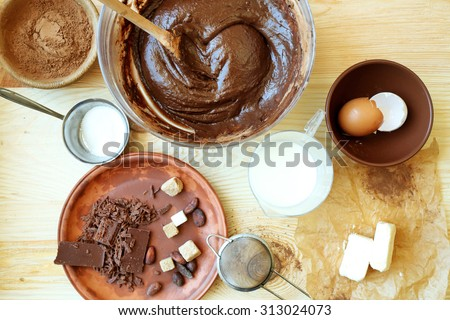 Preparing dough for chocolate pie on table close up - stock photo