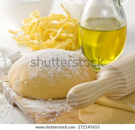 Preparing dough for fresh Italian pasta - stock photo