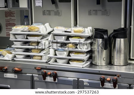 Preparing food for the passengers in the kitchen air plane. Lunch for airline passengers. Dinner menu at airplane. Meals for Aircraft on kitchen. - stock photo