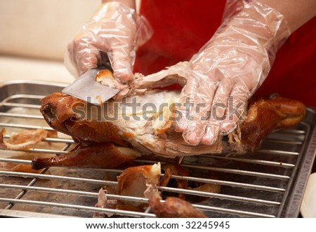Preparing food - sliced duck meat into small pieces. - stock photo