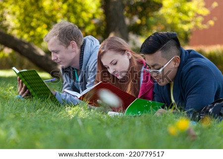 Preparing for exam on a fresh air - stock photo