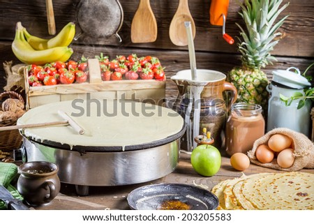 Preparing for pancakes with fruit - stock photo
