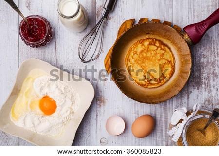 Preparing fresh pancakes. - Top view. - stock photo
