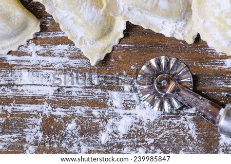Preparing fresh ravioli at the kitchen table.  - stock photo