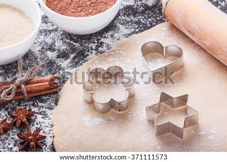 Preparing gingerbread cookies with ingredients - stock photo